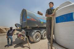 Hardship in the Desert_186 (EU Humanitarian Aid and Civil Protection) Tags: iraq fallujah anbar water nrc norwegianrefugeecouncil children desert tank boy tanker truck