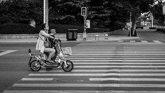 Transport 17/52 (Go-tea ) Tags: canon eos 100d bw bnw black blackwhite blackandwhithe white china urban city qingdao huangdao asia street asian chinese people outside outdoor boy woman mother son transport signal stoped motorbike together dangerous riding driving ready focus 52 project 17 kid child stand basket family lines