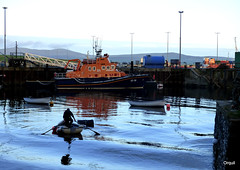 Sudden Waves At Stromness Harbour (orquil) Tags: sudden waves stromness sheltered harbour ferrywake smooth sea reflections oarsman rowingboat silhouette boats rnli lifeboat violetdorothyandkathleen 1716 southpier lightingpoles evening september orkney islands scotland uk unitedkingdom greatbritain orcades maritime nice interesting scenic colourful