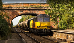 Colas Railfreight Class 60 no 60096 approaches Elton & Orston Station on 23-09-2016 with the Rectory to Lindsey discharged tanks (kevaruka) Tags: elton orston leicestershire station autumn 2016 september colour colours colas rail freight train dmu countryside east midlands nottinghamshire trains transport railway network british class 60 56 england yellow orange flickr front page thephotographyblog ilobsterit stock canon eos 5d mk3 ef100400 f4556l 5d3 5diii composition locomotive heritage historic lines leading rule thirds boobs milf sexy wife scenic scenery trees green 56113 railroad vehicle outdoor