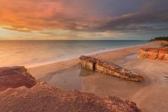 Firey Orange over Dripstone Cliffs (Louise Denton) Tags: casuarina cliffs dripstone beach darwin australia nt northernterritory orange sandstone cloud sea water