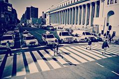 ... (life outside the fish bowl) Tags: street city nyc newyorkcity light shadow people bw usa cars lines buildings walking cyclist crossing traffic manhattan cab taxi columns bn pillars 8thavenue west33rdstreet lifeoutsidethefishbowl