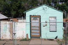 On Railroad Street (newmexico51) Tags: door railroad trees house newmexico southwest window yard fence casa wooden paint roswell blues western nm southwestern railroadstreet overpaint roswellnm gregorypeterson nrailroad