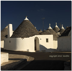 (tozofoto) Tags: street door city travel blue windows roof light shadow chimney sky italy white house travelling history home monument colors stone architecture canon cityscape village tourist tufa trulli puglia antenna attraction murge trullo stonehouse alberobello apulia itriavalley tozofoto