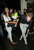 Dion Dreesens of the Dutch Olympic team getting amorous with a young lady as he leaves Chinawhite nightclub London, England