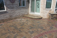 brussels paver patio (bretmarlandscape) Tags: brick landscape backyard landscaping patio entertainment seating pillars firepit landscaper landscapedesign seatwall landscapearchitect unilock bretmarlandscape