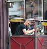 Ireland International and Leinster Rugby player Jamie Heaslip sitting outside his restaurant 'Bear' enjoying a bottle of wine Dublin, Ireland