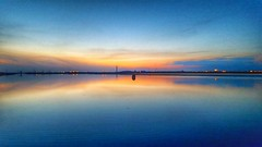 Sheppey sunset (Missnadined) Tags: kent sittingbourne isleofsheppey sunset reflection sundown blue symmetrical