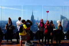 Top Of The Rock Selfie People 4 (andyfpp) Tags: fuji fujifilm x100t newyork nyc newyorkcity velvia saturated selfie stick iphone rock topoftherock shadows rockefeller manhattan