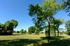 Grand Ledge Commerce Park (joeldinda) Tags: grandledge lawn eatoncounty 2016 michigan tree 3203 july shadowplay sky lightandshadow v2 nikon 20160726grandledgecommercepark1v2raw313203 nikon1v2 1v2
