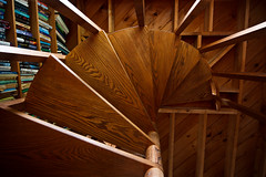 Under the Stairs (Emily Miller Kauai) Tags: wood spiral stairs staircase bookshelf