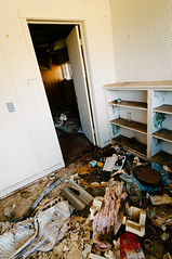 back storage room (Sam Scholes) Tags: door old house abandoned trash digital rural utah decay dirty shelf doorway peelingpaint decrepit shelves hiawatha d300 kingcoal usfco unitedstatesfuelcompany