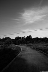 Under the Wire (John A. Gessner Photography) Tags: road street city blackandwhite bw michigan traverse line wires winding leading leelanau northernmichigan