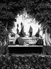Take a brake (Thomas Geiregger) Tags: street camera city people urban blackandwhite bw white black streets salzburg monochrome hat composition pen bench photography prime blackwhite fotografie thomas sleep candid streetphotography olympus best panasonic brake humans m43 mft tomge streetfotografie gx7 strasenfotografie epl1 microfourthirds microfourthird panasonicgx7 geiregger thomasgeireggertomgetomgetomge