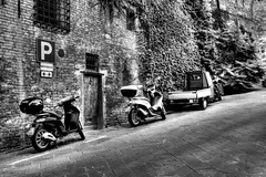 3 wheels or less (Neil_Clarke) Tags: street italy white holiday black monochrome canon mono three parking wheels transport sigma neil siena toscana moped 19 tone hdr clarke mapped 1850 50d