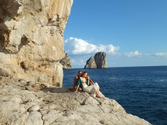 Faraglioni of Capri (E Pulejo) Tags: sea landscape island capri couple rocks sitting view stones
