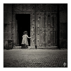 Curiosity... (fearghal breathnach) Tags: explore explorer curiousity littleexplorer squareformat square border monochrome sepia vintage doorway olddoor opening portal shadows child childphotography