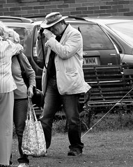 Village fete (4) (Neil. Moralee) Tags: july2016nikond7100 neilmoralee hemyock village fete neil moralee nikon d7100 man matute old laughing funny bald balding shirt moustache happy smile smiling back white mono monochrome bw candid face portrait outdoor peoplr natural light blackdown hills rural event local people rector vicar priest dogcollar photographer snap shoot hat jeans modern kiss hug