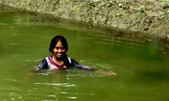 ~village life~ a village girl in the pond (~~ASIF~~) Tags: canon60d outdoor village girl swim pond water ripple color green reflections bangladesh
