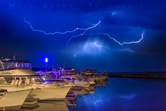 Lighting Up over the Marina (Matt Grans Photography) Tags: lightning lightening electrical storm clouds night blue weather california yacht boats marina harbor