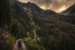 young explorer (Chrisnaton) Tags: southtyrol hiking kikingtrail childhood backpack mountains nature alpine wood eveningmood eveninglight eveningsky taserhhenweg littleexplorer hiker mountainstream videgg