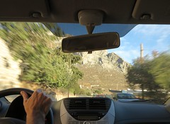being driven back from beach (squeezemonkey) Tags: kalymnos greece car interior traveling moving windscreen driving hand steeringwheel dashboard rearviewmirror blur mountains road cars