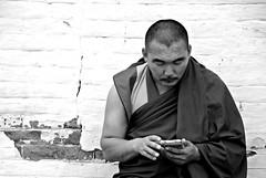 untitled (kharkhorin, mongolia) (bloodybee) Tags: kharkhorin mongolia asia travel man people bw monk portrait buddhism wall bricks