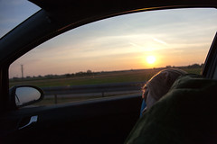 on the road 13 (rafaellobe) Tags: ontheroad asleep sleeping girl sun dawn poland motorway