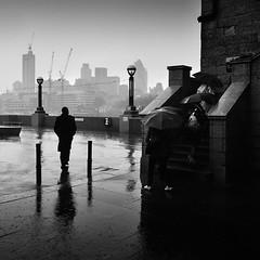 Steppin' Out (Jeff Vyse) Tags: storm man london rain umbrella oblivious stylish defiance steppinout ameeting needsabreak whatsonhismind itsonlyrain escapethepressuresofthecity justastroll