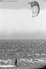 kitesurfing summer sessions, kelly wren chasing small summer waves, santa cruz, june 2012 [#024602] (Jeff Merlet Photography) Tags: ocean california leica sea portrait people woman usa santacruz kite film beach water silhouette sport analog 35mm blackwhite published surf day afternoon pacific wind action outdoor surfer board horizon wave windy sunny blowing surfing kitesurfing line riding negative 02 400 surfboard 135 rider kitesurf kiting 2012 fogbank visoflex foma rpl kiteboarder arista leicam6ttl aristaeduultra400 fomapan400 201206 scphoto visoflexiii kellywren cautionkites richardphotolab thelanetowaddell jeffmerletphotography photojeffmerletcom r0246 rpl0789 telyt40068 024602