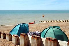 Wind/sun shelters! (larigan.) Tags: summer england sunshine tents horizon clams eastsussex englishchannel dinghy seasideresort lamanche breakwaters bexhillonsea fineweather larigan phamilton unrecognisablepeople gettyimageswants gettywants licensedwithgettyimages windshelters capturingenglishsummer popupshelters