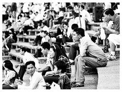 Distraction, Phnom Penh. (the jacal) Tags: street people urban blackandwhite bw white black architecture football asia cambodge cambodia khmer streetphotography olympus arena phnompenh olympic 135 olympicstadium zuiko indochine indochina sihanouk manuallens khmersmile om135mm vannmolyvann newkhmerarchitecture epl2 newkhmer 135mmmanuallens