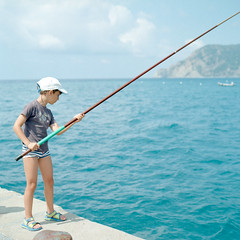Fisherboy (christian.senger) Tags: travel blue boy sea summer portrait sky italy 6x6 film water clouds rollei analog rolleiflex mediumformat geotagged outdoors europe mediterranean waves kodak liguria explore cap squareformat sl66 vernazza lightroom angler ektar carlzeiss vuescan colorperfect zeisscontest2012 christian_senger:year=2012