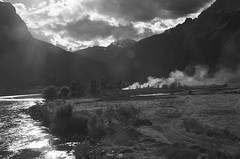 Peruvian valley (pdh96) Tags: blackandwhite sun white black mountains reflection peru clouds contrast landscape fire bright smoke valley lensflare flare bandw brightness