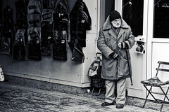 (The New Motive Power) Tags: old city shadow urban blackandwhite man cold wall contrast dark stand thought alone market sofia stall clothes bulgaria jackets   canon7d
