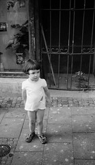 Lil Girl (Jennifer Stylls) Tags: street blackandwhite girl little poor littlegirl streetphotoghraphy