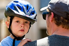 Green Around the Gills (Universal Stopping Point) Tags: bicycle kid holding toddler lexington kentucky helmet curls blonde fatherandson shoulder chinstrap