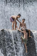 A helping hand (tmeallen) Tags: boys helping hand waterfall small dam cascades climbing splashing sheets water helpingeachother bali indonesia summertime sunlight