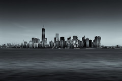 City jungle (_Sylvian) Tags: shoreline usa ocean manhattan landmark nyc water architecture buildings cityscape panorama blackandwhite newyork sky