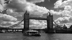 using the city's waterways (lunaryuna) Tags: uk england london urban city architecture urbanlandscape towerbridge transport boasts catamaran thamesclipper thecityasseenfromtheriver bridges urbanskies clouds sky cloudscape weather landscape blackwhite bw monochrome lunaryuna