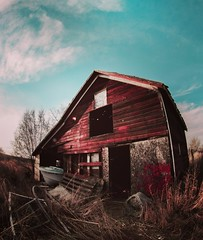 Gone fishin (Blockshadows) Tags: structure building boat outdoor canon toned tone russian peleng fisheye 8mm wideangle wide autumn fall exploration exploring urban somber moody muted tones blue red behind left colorado denver urbex abandoned sunset barn