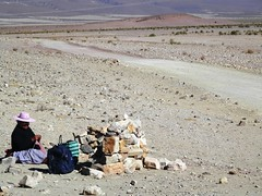 To knit away on the desert (magellano) Tags: donna bolivia strada road woman candid deserto desert sfezzurrare knit knitting seated sit sitting attesa wait farelamaglia lavorareamaglia capello hat sasso stone people