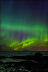Aurora (Jonas Thomn) Tags: aurora auroraborealis northernlights revontulet norrsken foxfire sea hav havet cliffs rocks klippor stenar vatten water sky himmel night natt stars stjrnor vgor waves