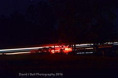 DSC_8172d (davids_studio) Tags: night lowlight passing train lighttrails