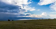 Rain starts over Baikal (buzzzerus) Tags: baikal lake russia travel siberia hiking nature landscape wallpaper beautiful weather rain sunny sky clouds outdoors