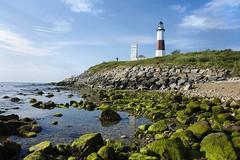 Montauk Lighthouse (G-daddyArt) Tags: sky lighthouse seascape beach rock canon landscape island coast long availablelight boulder shore montauk bluff 50d