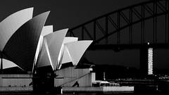 Sydney Opera House, Sydney Harbour Bridge and Blues Point Tower. (Andy Burton Oz) Tags: blackandwhite bw building theatre sydney australia icon entertainment tiles nsw operahouse sydneyharbour 2012 tiling sydneyoperahouse sydneyharbourbridge concerthall builtenvironment mrsmacquarieschair portjackson bluespointtower macquariest joernutzon stockcategories afsvrzoomnikkor70300mmf4556gifed andyburton nikond7000 aperture332