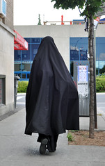 Muslim woman wearing abaya and niqab, Park Extension, Montreal (Blake Gumprecht) Tags: woman quebec robe montreal muslim islam hijab neighborhood immigrants niqab abaya immigration minorities multiculturalism ethnicdiversity khimar parkextension