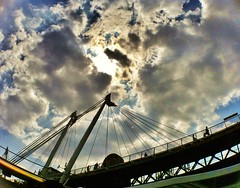 Under the sun, under the clouds, under the bridge where I sit (Broo_am (Andy B)) Tags: life lighting city morning bridge blue light shadow england sky people sun colour art beautiful up lines weather closeup thames clouds work buildings river walking gold evening amazing exposure heaven day skies shadows view god cloudy unique gorgeous awesome centre details extreme wide silhouettes bridges wideangle rays colourful olympics everyday storms col cluds beams sunbeams iphone bl busypeople iphonegraphy iphoneography instagram instagood instamood amazingbeautifulawesomeprettyglorious stormdaycloudyclearblue