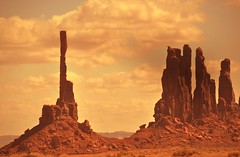 The Tranquility of Monument Valley (janetfo747) Tags: arizona rock gold utah day peace cloudy spires tranquility sacred navajo monumentvalley pinnacles monoliths splendor triballand